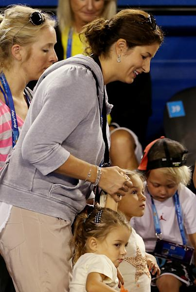 FILE - This Jan. 12, 2013 file photo shows Mirka, wife of tennis player Roger Federer, with their twin daughters Myla and Charlene to watch an exhibition match during the Kids Tennis Day at Melbourne Park ahead of the Australian Open tennis championship in Melbourne, Australia. Four-year old daughters Myla Rose and Charlene Riva have blissfully enhanced the lives of the 32-year old tenis superstar. With 17-time Grand Slam titles under his belt, family life bodes well for him. Federer even takes the kids on tour with him. (AP Photo/Aaron Favila, File)