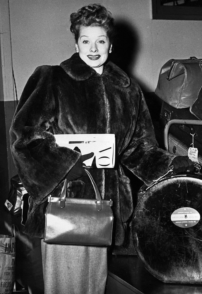 <p>The television comedian arrives at New York's LaGuardia Airport wearing a luxurious fur coat as she embarks on a Thanksgiving holiday, circa 1950s. </p>