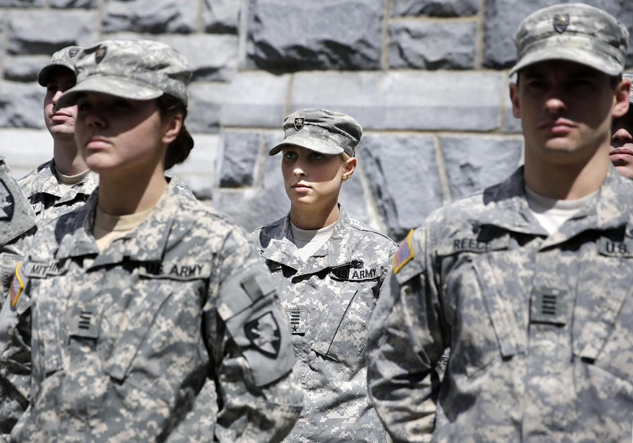 In this April 9, 2014 photo, West Point cadet Austen Boroff, center, of Chatham, N.J., stands in formation as she waits to march to lunch at the United States Military Academy in West Point, N.Y. With the Pentagon lifting restrictions for women in combat jobs, Lt. Gen. Robert Caslen Jr. has set a goal of boosting the number of women above 20 percent for the new class reporting this summer. (AP Photo/Mel Evans)