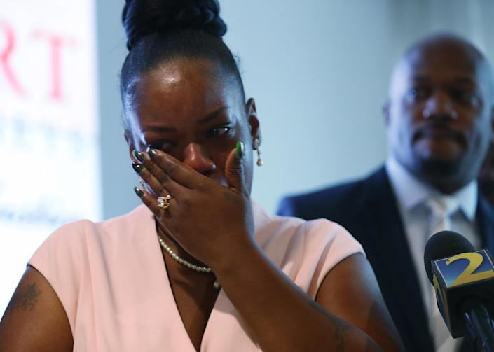 Image: Tomika Miller, the widow of Rayshard Brooks, wipes away tears as she participates in a press conference at her lawyers office after Fulton County District Attorney Paul L. Howard, Jr. announced 11 charges against former Atlanta Police Officer Garre (Joe Raedle / Getty Images)