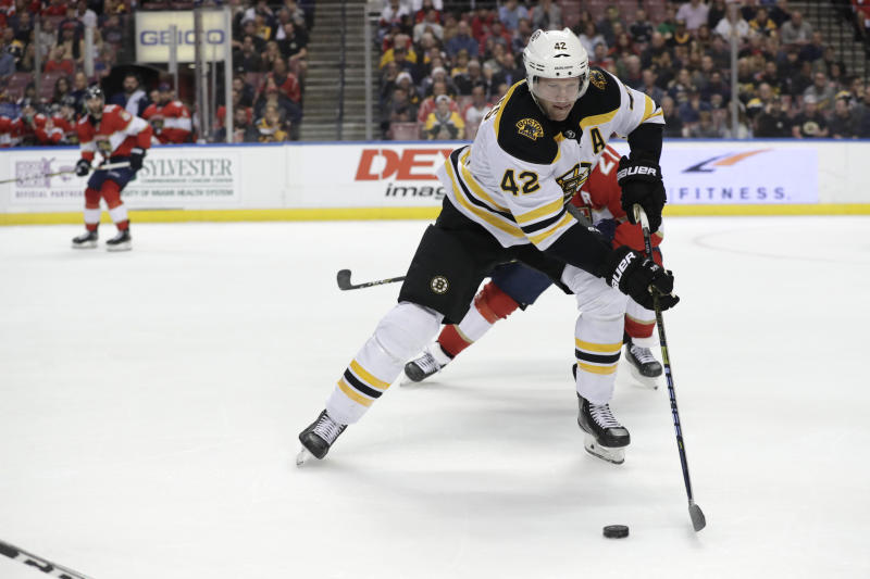 FILE - In this Dec. 14, 2019, file photo, Boston Bruins right wing David Backes (42) skates with the puck during the first period of an NHL hockey game in Sunrise, Fla. The NHL-leading Boston Bruins freed up salary cap space Friday, Feb. 21, 2020, by trading veteran forward David Backes and a first-round draft pick to the Anaheim Ducks for forward Ondrej Kase. (AP Photo/Lynne Sladky, File)