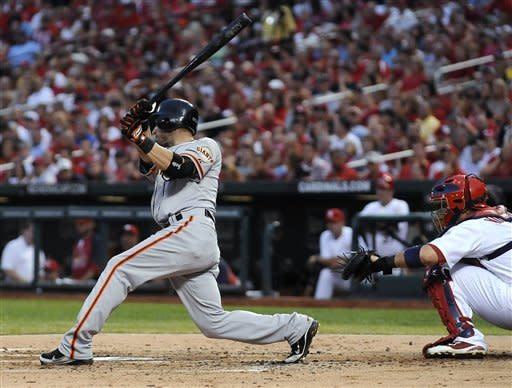 San Francisco Giants' Marco Scutaro hits an RBI single during the third inning of a baseball game against the St. Louis Cardinals ib Wednesday, Aug. 8, 2012, in St. Louis. (AP Photo/Jeff Curry)