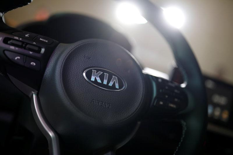 The logo of Kia Motor is seen on a steering wheel of new Morning compact car during its unveiling ceremony in Seoul
