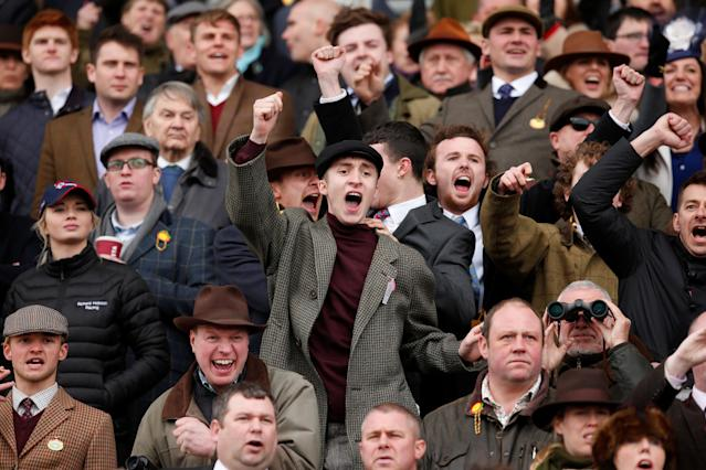 Horse Racing - Cheltenham Festival - Cheltenham Racecourse, Cheltenham, Britain - March 14, 2018 Racegoers react as they watch the racing Action Images via Reuters/Matthew Childs