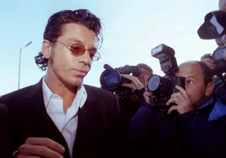 FILE PHOTO: Michael Hutchence, lead singer of the group INXS, arrives at Maidstone Magistrates Court