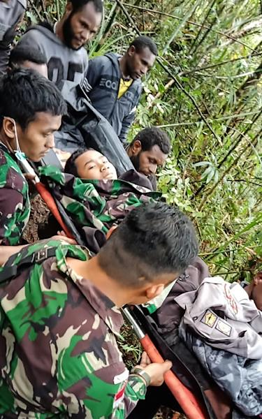 A 12-year-old boy was the sole survivor of a plane crash that killed eight people in mountainous eastern Indonesia (AFP Photo/Handout)