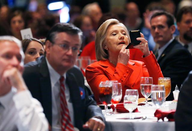 Clinton touching up her makeup before speaking at the Iowa Democratic Pary's Hall of Fame Dinner in 2015. (Jim Young / Reuters)