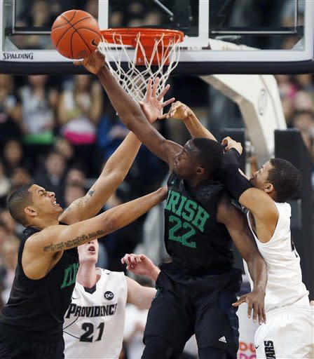 Notre Dame's Zach Auguste, left, and Jerian Grant (22) battle for a rebound with Providence's Lee Goldsbrough (21) and Josh Fortune, right, in the first half of an NCAA college basketball game in Providence, R.I., Saturday, Feb. 16, 2013. (AP Photo/Michael Dwyer)