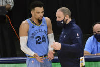 Memphis Grizzlies guard Dillon Brooks talks to coach Taylor Jenkins during the second half of the team's NBA basketball game against the San Antonio Spurs on Wednesday, Dec. 23, 2020, in Memphis, Tenn. (AP Photo/Brandon Dill)