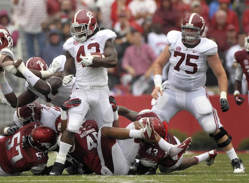 Arkansas defensive tackle Jared Green (57) and linebackers Alonzo Highsmith (45), and Tenarius Wright (43) attempt to tackle Alabama running back Eddie Lacy (42) as offensive lineman Barrett Jones (75) looks on during second quarter action of an NCAA college football game in Fayetteville, Ark., Saturday, Sept. 15, 2012. (AP Photo/David Quinn)