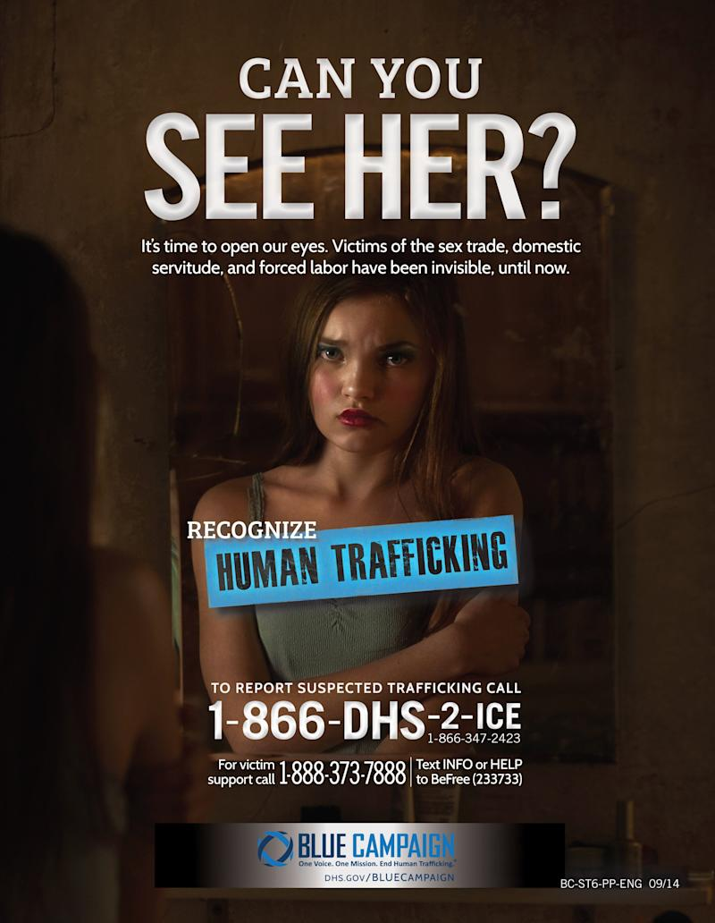 A Department of Homeland Security human trafficking awareness poster directs callers to an ICE hotline. (Photo: ASSOCIATED PRESS)