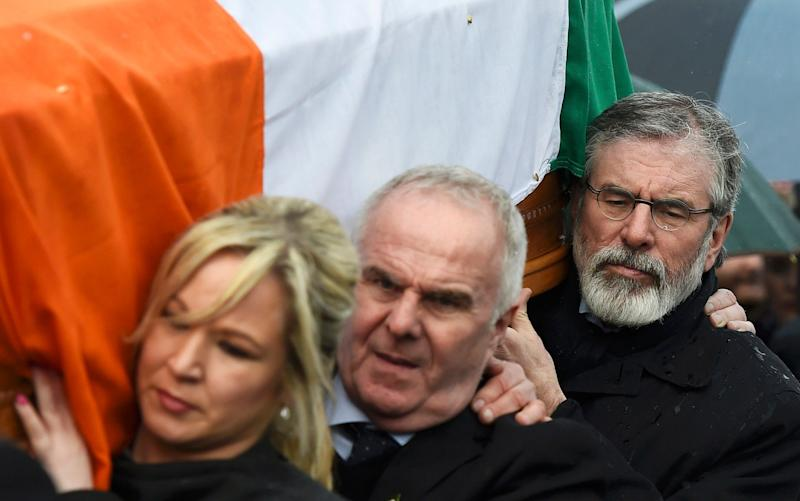 Sinn Feinn Leader Michelle O'Neill and Sinn Feinn President Gerry Adams carry the coffin of Martin McGuinness through the streets of Londonderry, Northern Ireland - Credit: CLODAGH KILCOYNE /REUTERS
