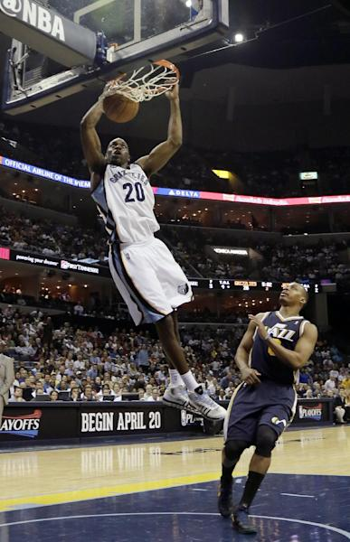 Memphis Grizzlies' Quincy Pondexter (20) dunks over Utah Jazz's Randy Foye during the first half of an NBA basketball game in Memphis, Tenn., Wednesday, April 17, 2013. (AP Photo/Danny Johnston)