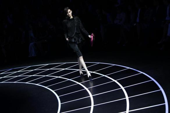 A model presents a creation for the Giorgio Armani fashion show in Beijing, May 31, 2012.