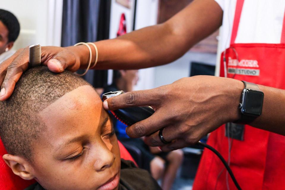 Kids in Cleveland were treated to free back-to-school haircuts and school supplies at Premier Barber Studio over the weekend. (Photo: Courtesy Ronald Bridges and Jermaine Smith)
