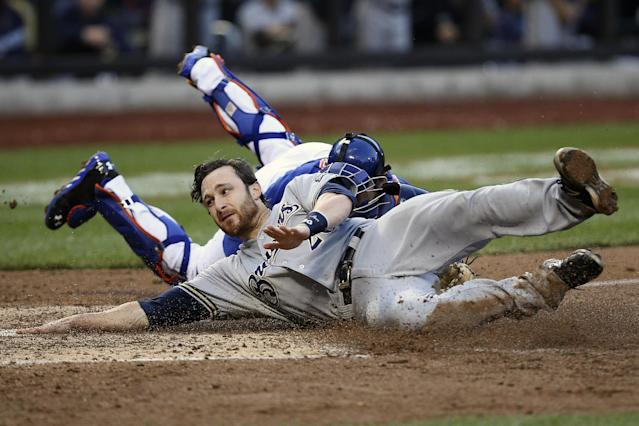 Milwaukee Brewers catcher Jonathan Lucroy (20) is tagged out at home plate by New York Mets catcher Anthony Recker (20) in the sixth inning of a baseball game at Citi Field, Saturday, Sept. 28, 2013, in New York. (AP Photo/John Minchillo)