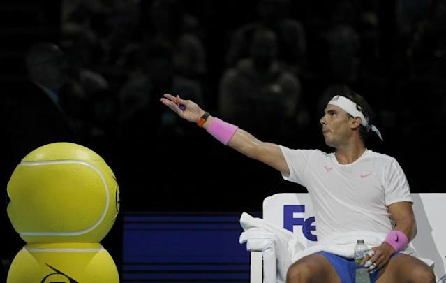 Rafael Nadal remonstrates with the umpire during a break in play against Alexander Zverev at the ATP Finals (AFP Photo/Adrian DENNIS)