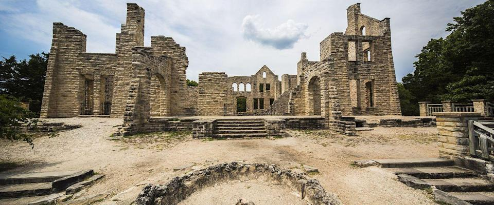 """<p><strong>Ha Ha Tonka State Park - Camdenton, MO</strong></p><p>Walk along the Ha Ha Tonka State Park and you'll wander upon the ruins of a turn-of-the-century stone castle. The building was destroyed by a fire in the 1940s, and was purchased by the state and turned into a park in the late 70s. The <a href=""""https://www.atlasobscura.com/places/ha-ha-tonka-castle-ruins"""" rel=""""nofollow noopener"""" target=""""_blank"""" data-ylk=""""slk:original owner"""" class=""""link rapid-noclick-resp"""">original owner</a> died in an accident before the castle was completed, and it's possible his spirit still walks the land to this day.</p><p>Photo: Wikimedia/<a href=""""https://en.wikipedia.org/wiki/Ha_Ha_Tonka_State_Park#/media/File:Ha-Ha-Tonka.jpg"""" rel=""""nofollow noopener"""" target=""""_blank"""" data-ylk=""""slk:ThePhotoRun"""" class=""""link rapid-noclick-resp"""">ThePhotoRun</a></p>"""