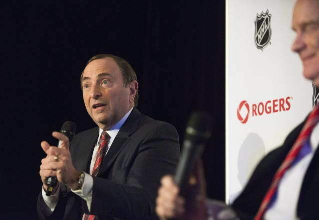 NHL Commissioner Gary Bettman speaks during a news conference alongside Scott Moore, president of Sportsnet, in Toronto on Tuesday, Feb. 4, 2014. Nearly 500 regular season games will air in Canada as part of the blockbuster 12-year agreement between Rogers Communications and the NHL. That's a jump of more than 400 per cent from the number of games shown during the regular season on the CBC, which currently holds the broadcast rights. (AP Photo/The Canadian Press, Aaron Vincent Elkaim)