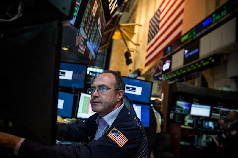 A trader works on the floor of the New York Stock Exchange on July 3, 2014 (AFP Photo/Andrew Burton)