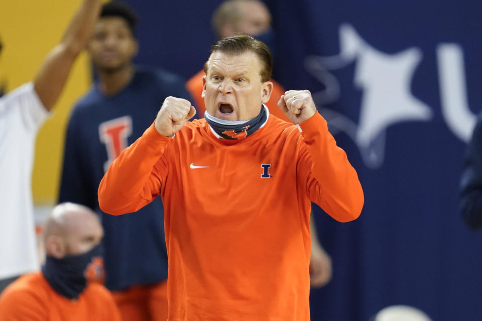 FILE - Illinois head coach Brad Underwood reacts to a play against Michigan in the second half of an NCAA college basketball game in Ann Arbor, Mich., in this Tuesday, March 2, 2021, file photo. Nobody will get a lump in their throat or start sizing up glass slippers for programs like these Alabama, Illinois, Baylor. They're not underdogs. They're hardly unknown. What they are is a group of new teams with well-recognized names in the NCAA Tournament, and they're hoping to keep making life hard on the programs that have long had a stranglehold on March. (AP Photo/Paul Sancya, File)