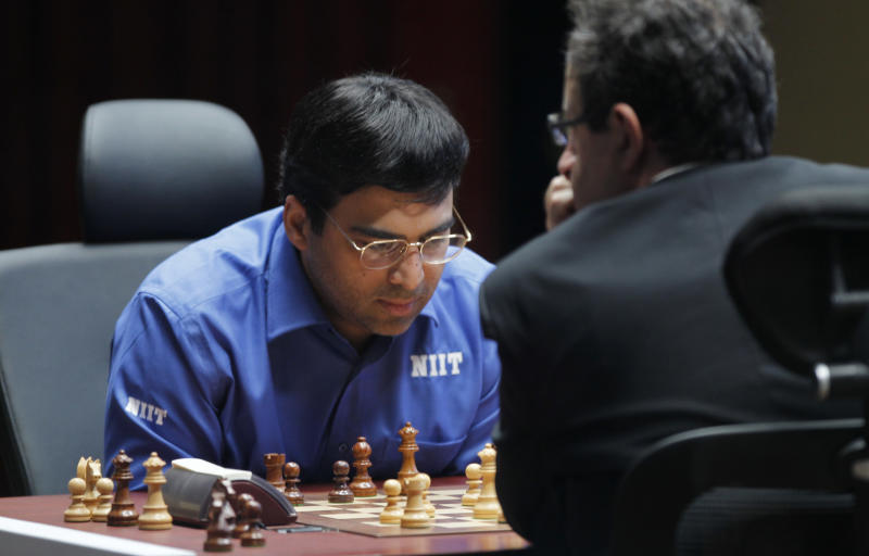 World Chess champion Viswanathan Anand from India, contemplates his next move during a match against Boris Gelfand of Israel at the FIDE World Chess Championship tie break match at Moscow's Tretyakovsky State Gallery, Russia, Wednesday, May 30, 2012. (AP Photo/Misha Japaridze)