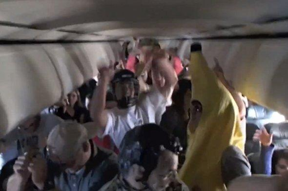 Aviation chiefs to investigate after passengers dance in aisles on flight