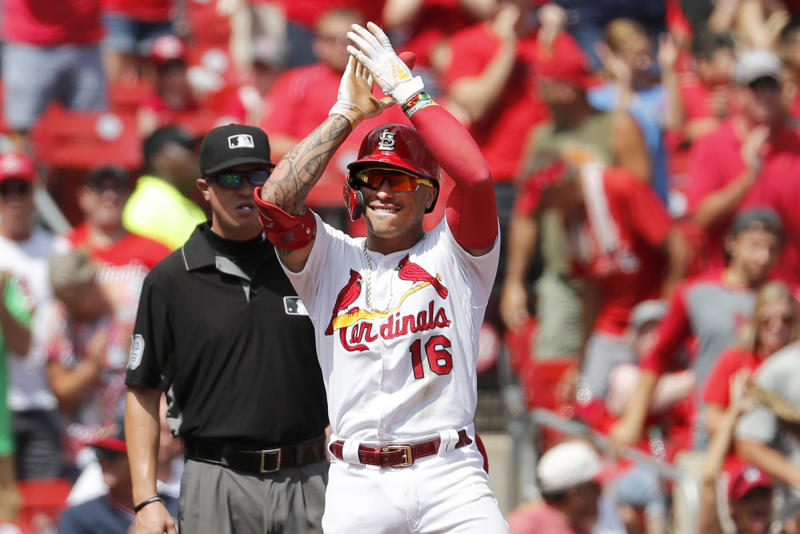 St. Louis Cardinals' Kolten Wong (16) celebrates after hitting an RBI-triple during the first inning of a baseball game against the San Francisco Giants, Monday, Sept. 2, 2019, in St. Louis. (AP Photo/Jeff Roberson)
