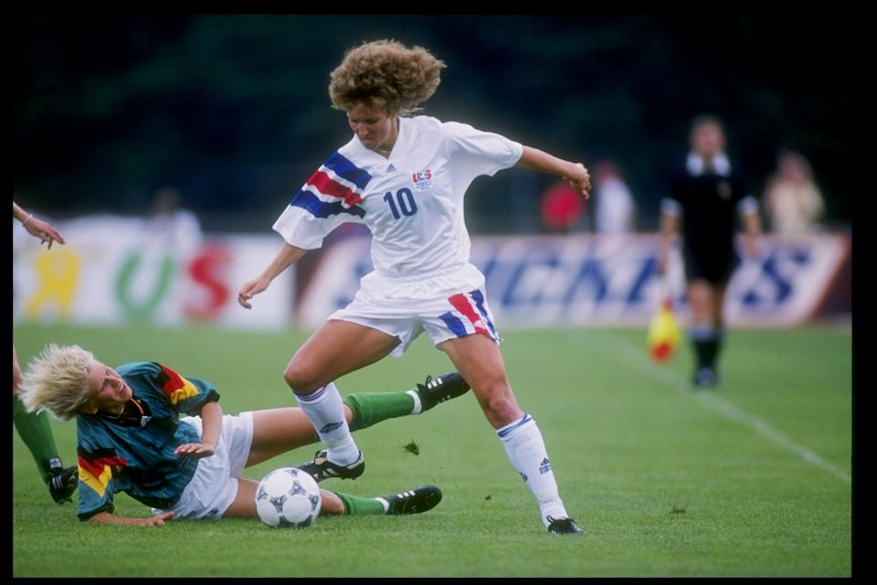 Michelle Akers-Stahl of the USA fights for the ball during a game against Germany in Fairfax, Virginia.  The USA won the game 2-1. Mandatory Credit: Doug Pensinger /Allsport