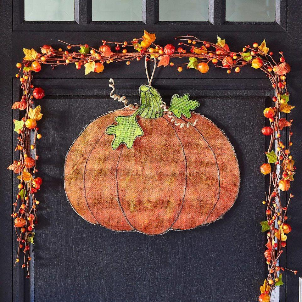 "<p>In lieu of a traditional wreath, celebrate pumpkin season with this versatile piece.</p><p><strong>Get the tutorial at <a href=""http://www.michaels.com/burlap-pumpkin-door-hanger/B_72401.html?productsource=projects#q=halloween+door&start=2"" rel=""nofollow noopener"" target=""_blank"" data-ylk=""slk:Michaels"" class=""link rapid-noclick-resp"">Michaels</a>. </strong></p><p><a class=""link rapid-noclick-resp"" href=""https://www.amazon.com/Fabric-Editions-MDGB-BUR5-24-Inch-Natural/dp/B004BPEAWO/?tag=syn-yahoo-20&ascsubtag=%5Bartid%7C10050.g.22350299%5Bsrc%7Cyahoo-us"" rel=""nofollow noopener"" target=""_blank"" data-ylk=""slk:SHOP BURLAP"">SHOP BURLAP</a><br></p>"
