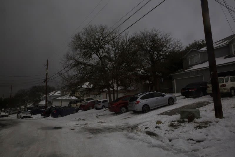 FILE PHOTO: A neighborhood experiences a power outage after winter weather caused electricity blackouts in San Marcos
