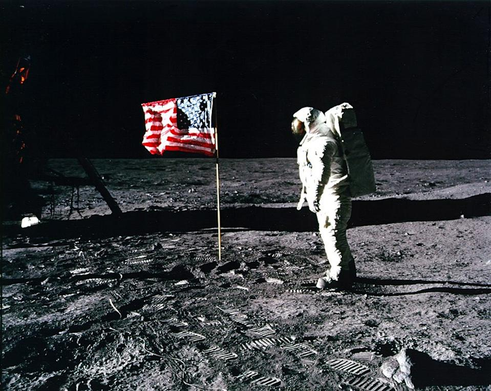 'Apollo 11' astronaut Edwin 'Buzz' Aldrin stands by the American flag planted on the surface of the moon on July 20, 1969.