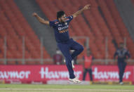 India's Shardul Thakur celebrates the dismissal of England's Dawid Malan during the fifth Twenty20 cricket match between India and England at Narendra Modi Stadium in Ahmedabad, India, Saturday, March 20, 2021. (AP Photo/Ajit Solanki)
