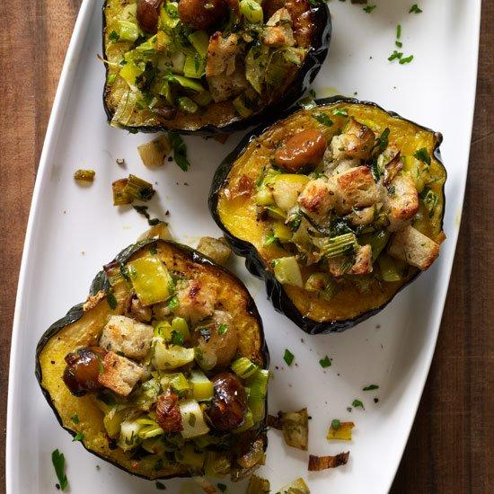 """<p>Halved acorn squash make perfect single-serving bowls. These make a great vegetarian main course for any winter holiday, but they're also a festive accompaniment to turkey, ham or roast goose.</p><p><a href=""""https://www.foodandwine.com/recipes/baked-acorn-squash-with-chestnuts-apples-and-leeks"""">GO TO RECIPE</a></p>"""