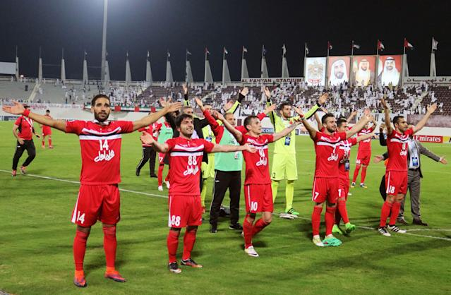 Persepolis's players celebrate after winning the AFC Champions League qualifying football match between UAE's Al-Wahda and Iran's Persepolis on February 28, 2017