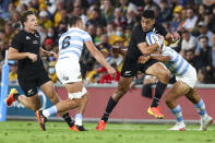 New Zealand's Rieko Ioane runs at the defense during the Rugby Championship test match between the All Blacks and the Pumas in Brisbane, Australia, Saturday, Sept. 18, 2021. (AP Photo/Tertius Pickard)