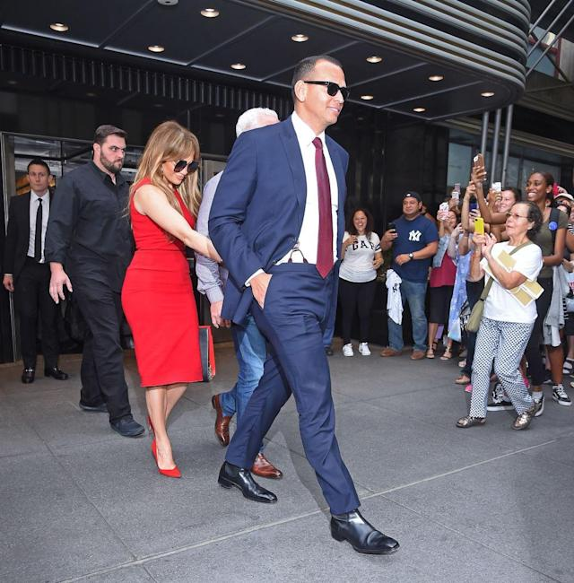 <p>In September, A-Rod was spotted out without a tie, but he threw on some red later in the day to match his lady. (Photo: Getty Images) </p>