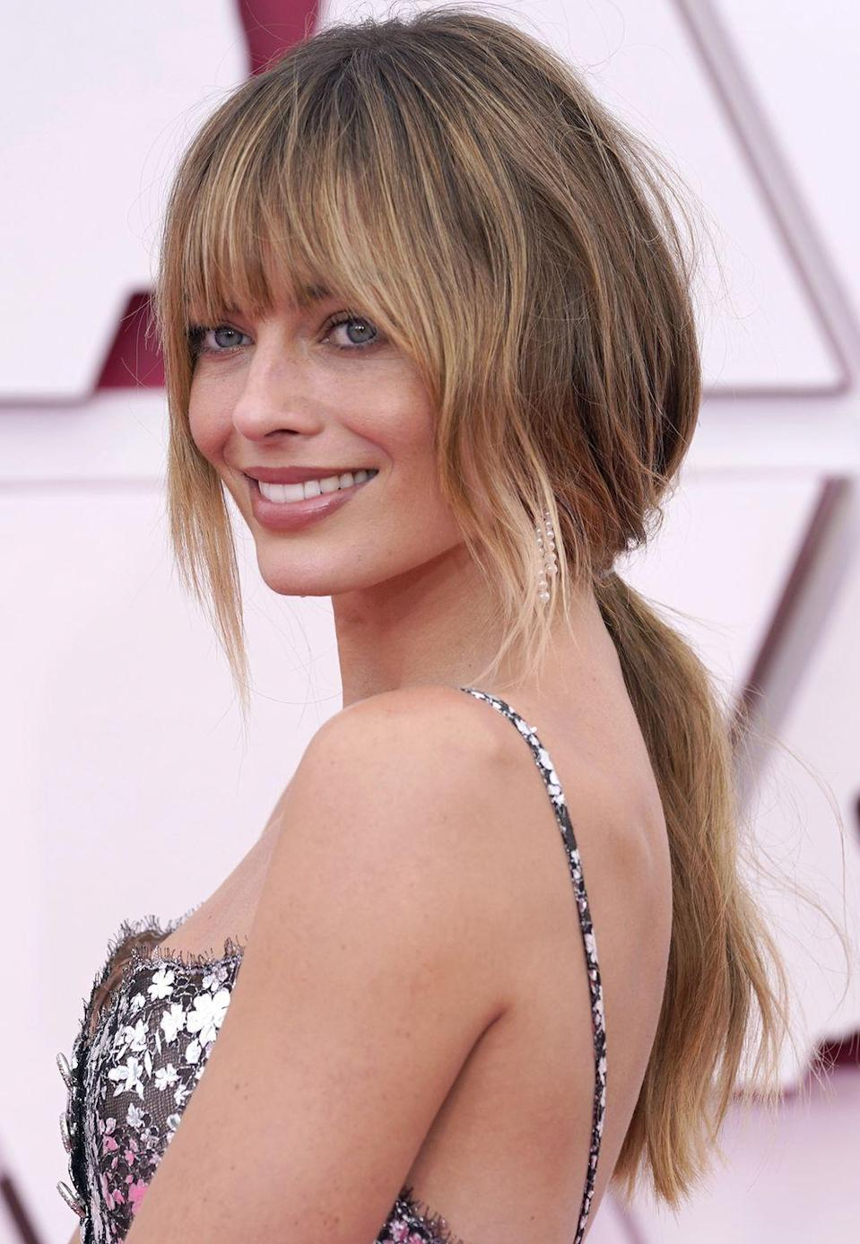 <p><strong>Margot Robbie</strong>'s hair is romantic and undone while still looking fresh. For color like this, keep your roots natural and begin a gradual fade in color to sun-kissed blonde. Eye-sweeping bangs make this color even dreamier. </p>
