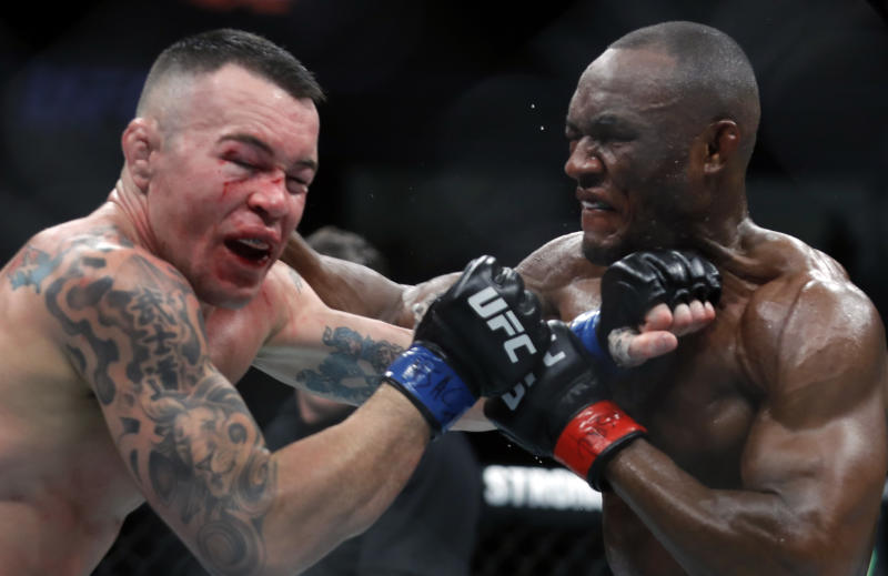 LAS VEGAS, NEVADA - DECEMBER 14: Colby Covington (L) takes a punch from UFC welterweight champion Kamaru Usman in their welterweight title fight during UFC 245 at T-Mobile Arena on December 14, 2019 in Las Vegas, Nevada. Usman retained his title with a fifth-round TKO. (Photo by Steve Marcus/Getty Images)