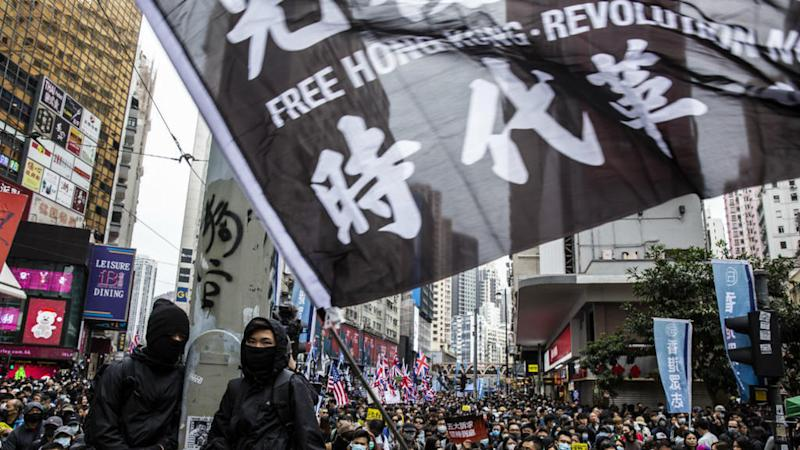 Hong Kong protesters vow to 'keep fighting' in New Year's Day march