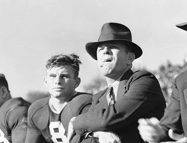 "<p>1952 — TCU coach Dutch Meyer publishes the book, ""Spread Formation Football."" Meyer only moderately spread the field, utilizing wingbacks instead of running backs, but he also dabbled with a no-huddle attack and shotgun formation. (Photo credit: AP) </p>"