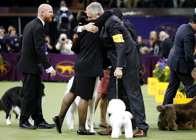 Handler Bill McFadden and Flynn, a bichon frise and winner of Best In Show are congratulated at the 142nd Westminster Kennel Club Dog Show in New York, U.S., February 13, 2018. Picture taken February 13, 2018. REUTERS/Brendan McDermid