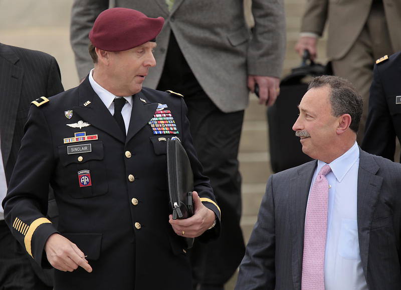 Brig. Gen. Jeffrey Sinclair, left, who admitted to inappropriate relationships with three subordinates, leaves court while talking with his defense attorney Richard Scheff, right, at Fort Bragg, N.C., Wednesday, March 19, 2014. Closing arguments were presented Wednesday, but no sentence was reached. (AP Photo/Ted Richardson)
