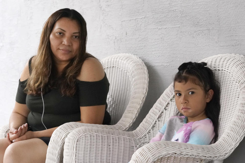Temporary Protected Status (TPS) holder Lili Montalvan, left, of El Salvador, poses for a photo with her daughter Roxana Gozzer, 6, Sunday, Oct. 25, 2020, at their home in Fort Lauderdale, Fla. (AP Photo/Wilfredo Lee)