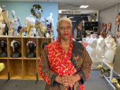 """Judi Henderson, owner of Mannequin Madness, stands inside her store, Tuesday, Sept. 22, 2020, in Oakland, Calif., which sells used mannequins, hosts art classes and has a portrait studio for people and dogs. She received a grant from the Oakland African American Chamber of Commerce's """"Resiliency Fund,"""" which seeks to help Black-owned businesses stay afloat during the coronavirus pandemic. (AP Photo/Terry Chea)"""