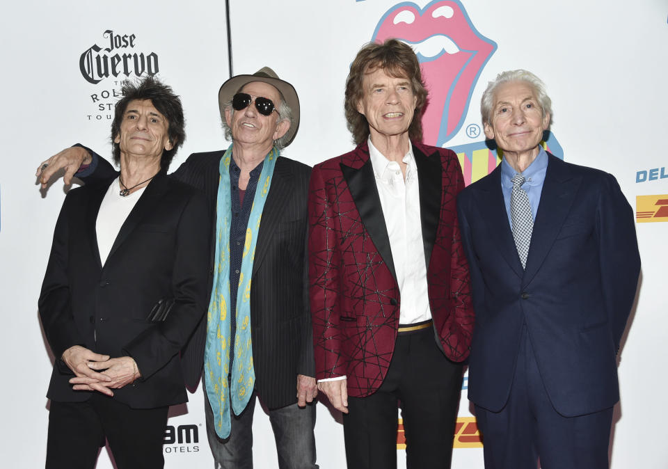 """FILE - Members of The Rolling Stones, from left, Ronnie Wood, Keith Richards, Mick Jagger and Charlie Watts attend the opening night party for """"Exhibitionism"""" on Nov. 15, 2016, in New York. Watts' publicist, Bernard Doherty, said Watts passed away peacefully in a London hospital surrounded by his family on Tuesday, Aug. 24, 2021. He was 80. (Photo by Evan Agostini/Invision/AP, File)"""
