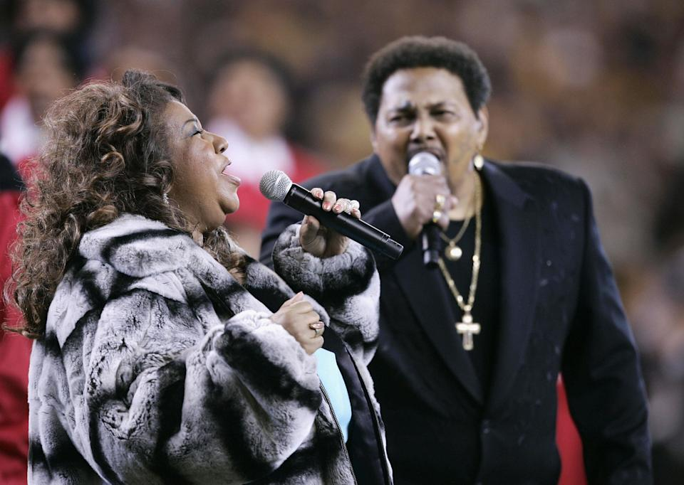 Aretha Franklin and Aaron Neville sing the American National Anthem prior to Super Bowl XL on Feb. 5, 2006in Detroit, Michigan. The Pittsburgh Steelers facedthe Seattle Seahawks.