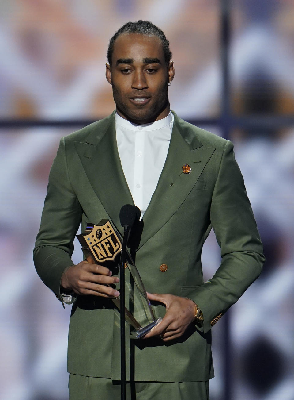 AP Defensive Player of the Year New England Patriots' Stephon Gilmore speaks at the NFL Honors football award show Saturday, Feb. 1, 2020, in Miami. (AP Photo/David J. Phillip)