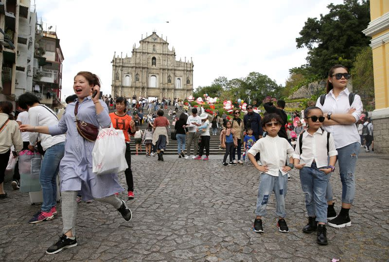 Tourists visit the Ruins of St. Paul's in Macau