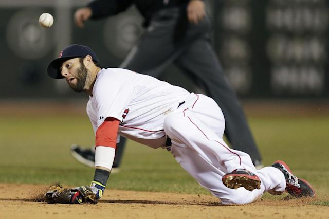 Boston Red Sox second baseman Dustin Pedroia knocks down the ball on a ground out by Texas Ranger J.P. Arencibia during the fifth inning of the MLB American League baseball game at Fenway Park, Monday, April 7, 2014, in Boston.(AP Photo/Charles Krupa)